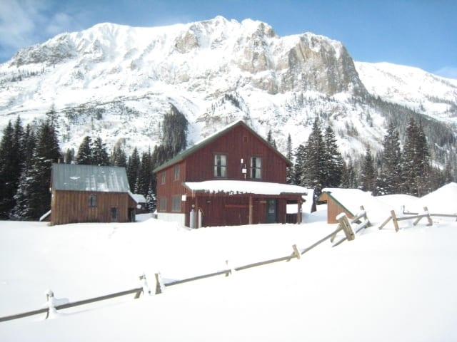 Maroon Cabin Exterior